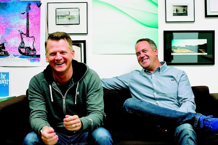 Andy Laats (left) and Chad DiNenna, co-founders of Encinitas-based Nixon, bought back the company from Billabong last year. Nixon