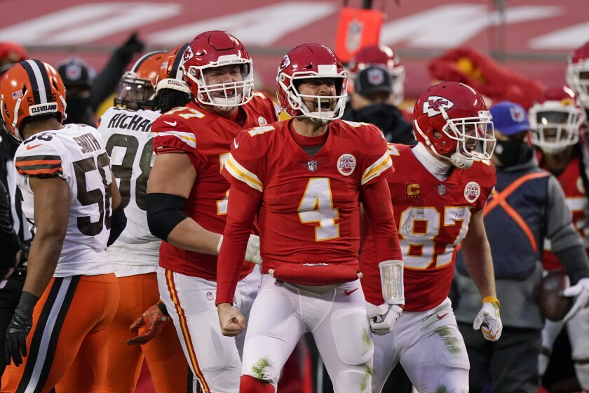 Kansas City Chiefs quarterback Chad Henne celebrates after a run during the second half of an NFL divisional round football game against the Cleveland Browns, Sunday, Jan. 17, 2021, in Kansas City. (AP Photo/Charlie Riedel)