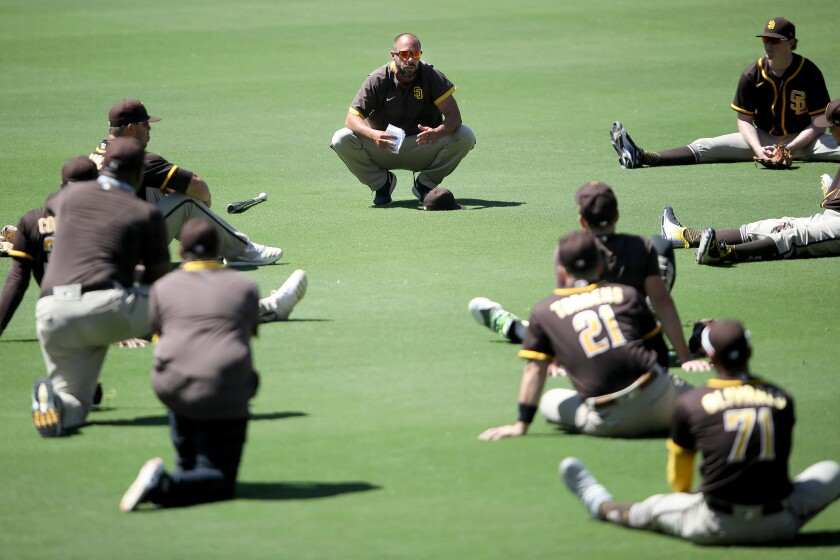 Padres manager Jayce Tingler talks with the team during their summer workouts at Petco Park.