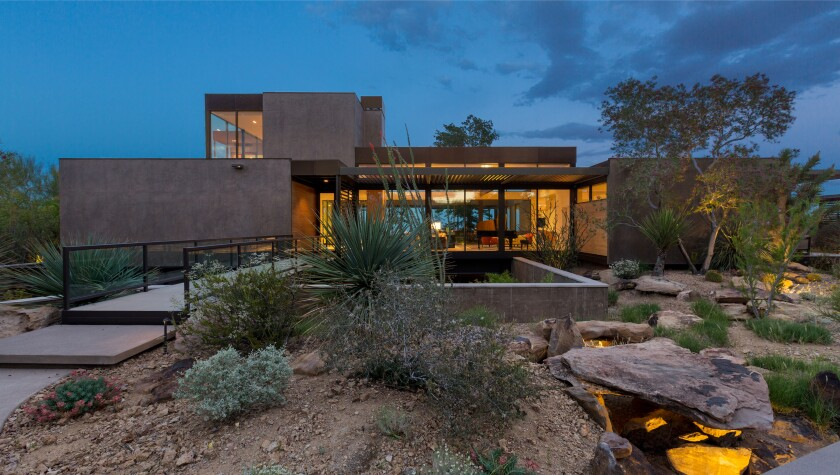 Spanning 1.5 acres, the gated estate holds a 13,000-square-foot mansion, a subterranean garage and a pool with desert views.