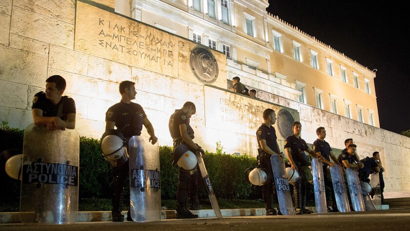 Police stand guard at the Greek Parliament in Athens.