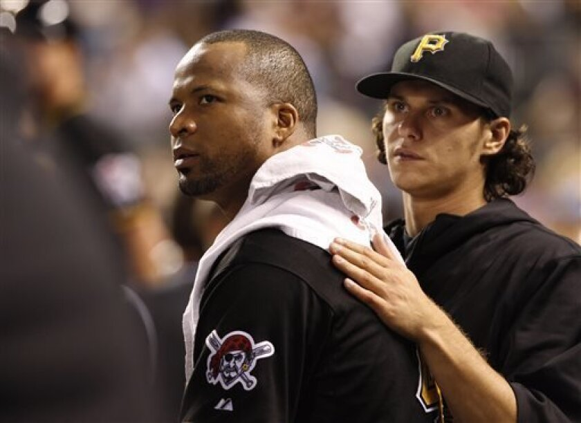 Pittsburgh Pirates starting pitcher Francisco Liriano, left, is consoled by pitcher Jeff Locke after Liriano was pulled from the mound against the Colorado Rockies in the third inning of a baseball game in Denver on Friday, Aug. 9, 2013. (AP Photo/David Zalubowski)