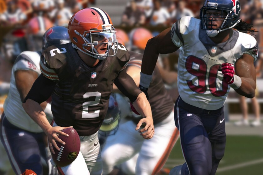 A screenshot from Madden NFL 15 shows Cleveland quarterback Johnny Manziel on the run against the Houston defense. Mobile quarterbacks like Manziel are useful for gamers like Eric 'The Problem' Wright, one of the top Madden players in the world.