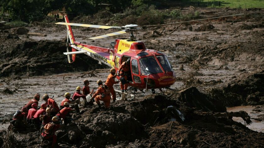 Firefighters are resupplied as they search last week for victims of the Vale dam collapse in Brumadinho, Brazil.