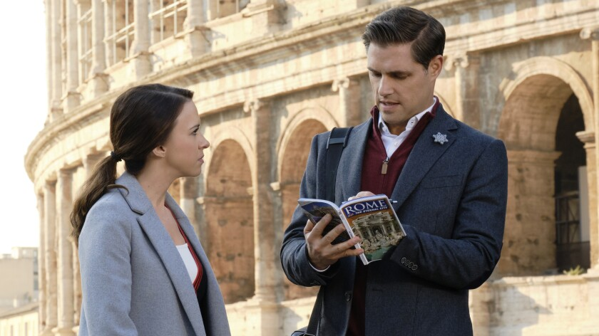 """Lacey Chabert and Sam Page in """"Christmas in Rome"""" on Hallmark Channel"""