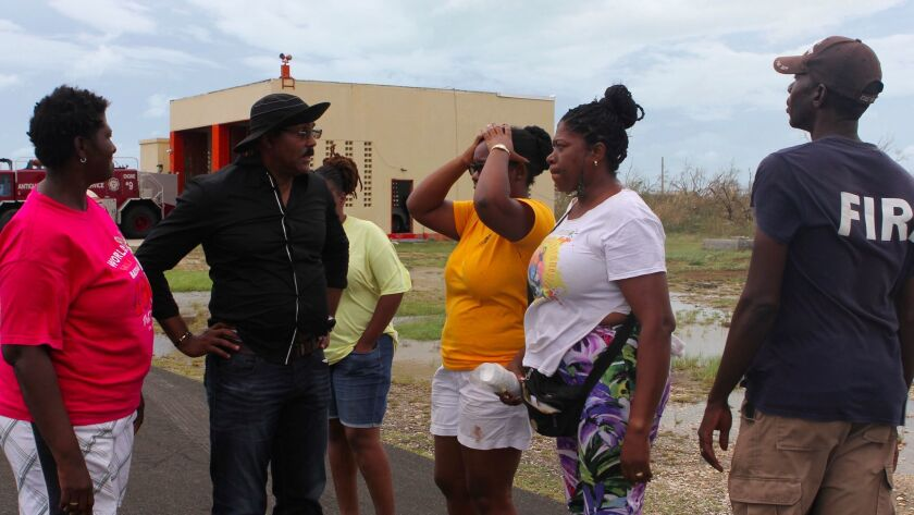 Prime Minister Gaston Browne, second from left, on Sept. 7, 2017, with people affected by Hurricane Irma on the island of Barbuda.