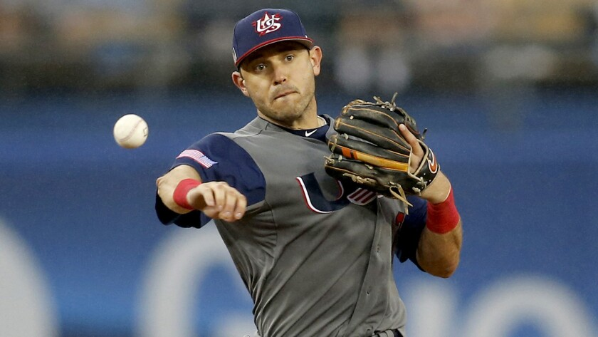 U.S. second baseman Ian Kinsler makes a play against Japan on Tuesday in the World Baseball Classic. Kinsler appears to not be a fan of flamboyant displays of passion in baseball.