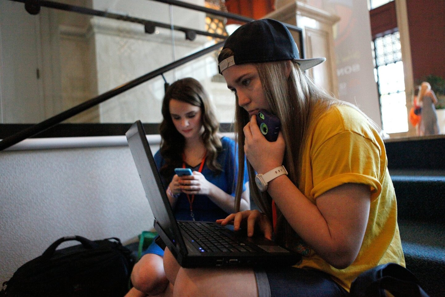 "(left) Sophia Landry, 17, (right) Kayla Barlett, 16, of Lake Charles-Boston Academy prepare their video for the US-Russia SEE Education & Youth ""Open Doors"" Symposium competition at the Student Television Network Convention Thursday."