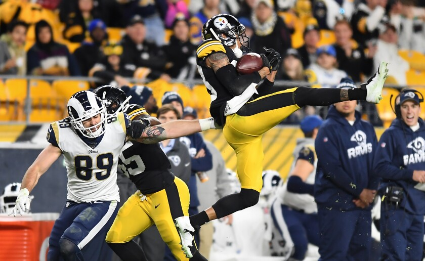 Steelers cornerback Joe Haden intercepts a pass intended for Rams tight end Tyler Higbee in the third quarter Sunday.