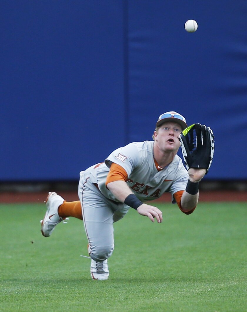 Texas center fielder Zane Gurwitz dives for a ball hit by Texas Tech's Tim Proudfoot in the third inning of a first round game at the NCAA college Big 12 conference baseball tournament in Tulsa, Okla., Wednesday, May 20, 2015. Burwitz caught the ball for the out. Texas won 2-1. (AP Photo/Sue Ogrocki)