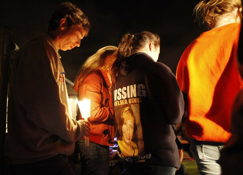 Thousands of mourners gathered at St. Michael Catholic Church in Poway on Tuesday after Chelsea King's body was found.