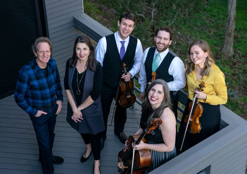 John Malashock (left) and Kate Hatmaker with members of the Kontras Quartet: violinist Francois Henkins, violist Benjamin Weber, cellist Jean Hatmaker and violinist Eleanor Bartsch.