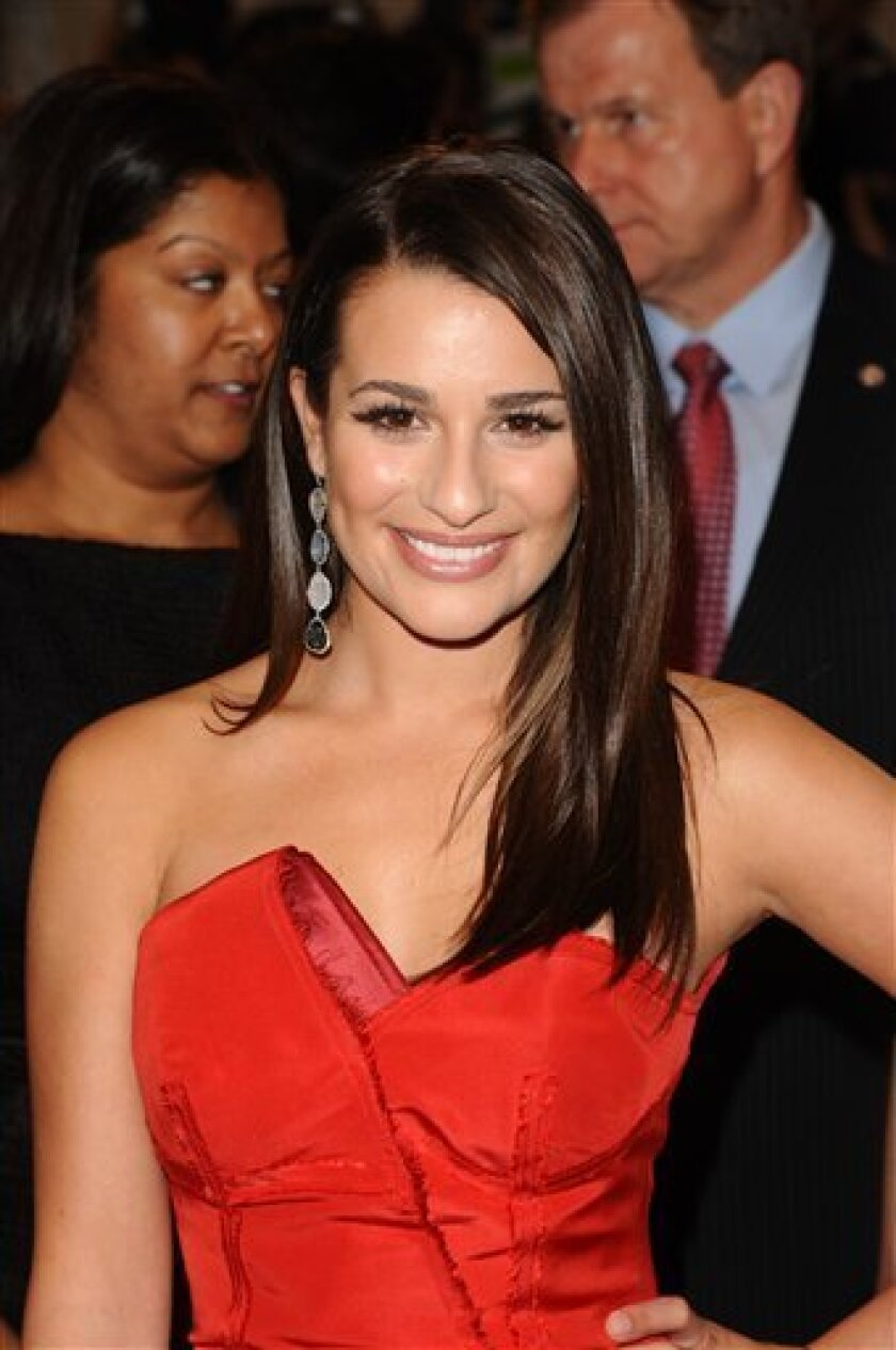 "Actress Lea Michele from ""Glee"" arrives at the Metropolitan Museum of Art Costume Institute gala, Monday, May 2, 2011 in New York. (AP Photos/Peter Kramer)"
