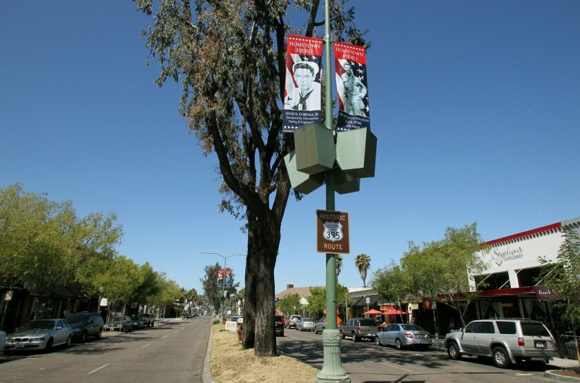 Banners with portraits of those who have served in the military hang above Grand Avenue in downtown Escondido.