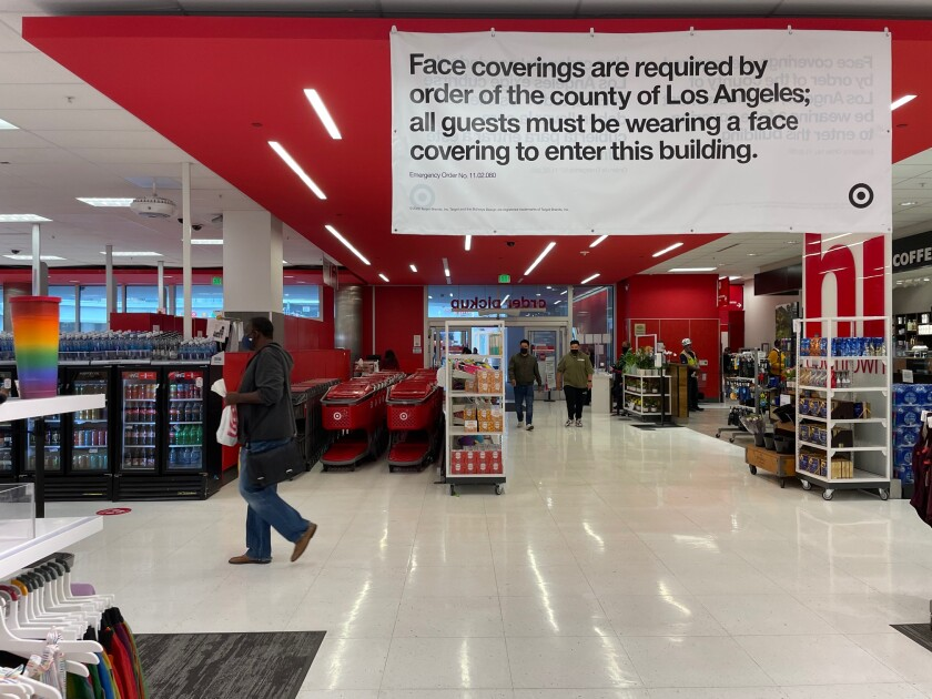 Signage inside a Target advertises a mask mandate