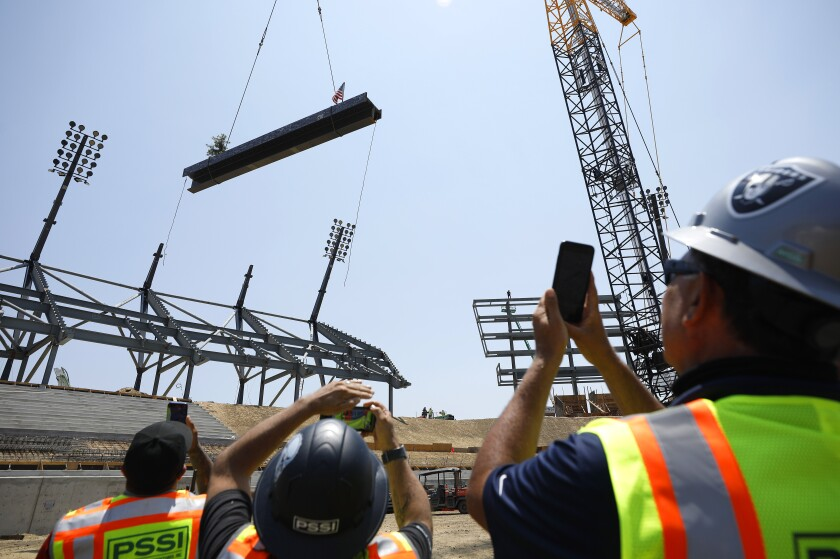 SDSU and members of Clark Construction Group held a steel topping-out ceremony for Aztec Stadium.