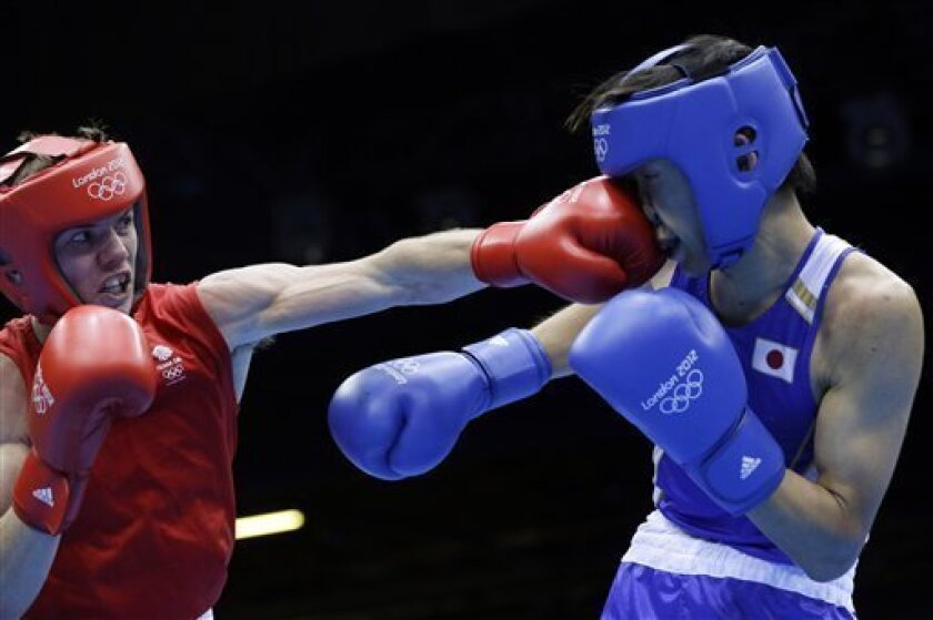 Britain's Luke Campbell, left, fights Japan's Satoshi Shimizu in a bantamweight 56-kg semifinal boxing match at the 2012 Summer Olympics, Friday, Aug. 10, 2012, in London. (AP Photo/Patrick Semansky)