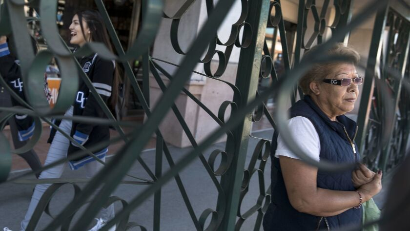 Emilia Mata, 64, waits for a bus on Pacific Avenue in Huntington Park. Mata rides three buses to get to her factory job.