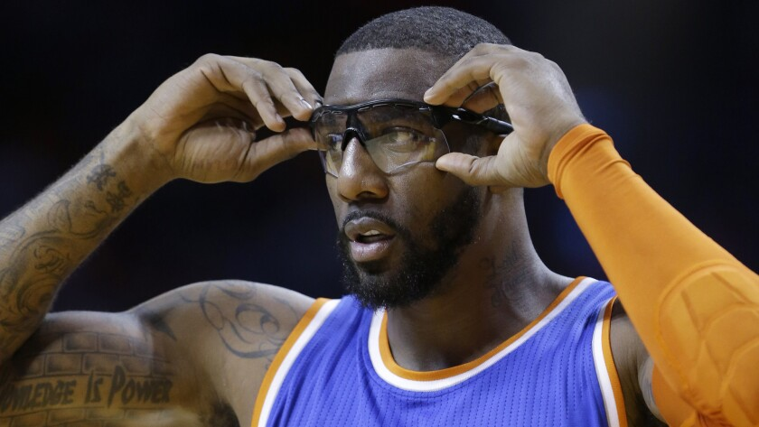 New York Knicks center Amare Stoudemire adjusts his glasses during a game against the Miami Heat on Feb. 9. Stoudemire can provide a valuable role off the bench when he's healthy.