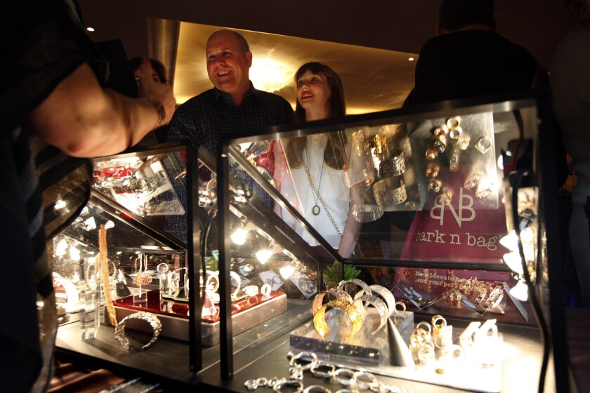 """Actor James DuMont of """"Dallas Buyers Club,"""" and his daughter Sinclair, 12, talk with Annamarie Sabo at the La Corza booth at the Ultimate in Luxury Red Carpet Style Lounge co-hosted by Wolfgang Puck and benefiting the Society for the Prevention of Cruelty to Animals Los Angeles on Saturday at the Montage Hotel in Beverly Hills."""
