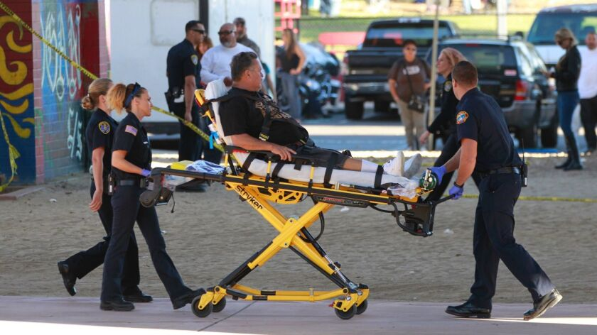 An unidentfied person is transported to a hospital after being injured when a vehicle plunged off the San Diego-Coronado Bridge into an afternoon crowd at Chicano Park.