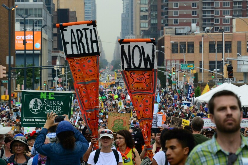 Demonstrators march in New York to support measures combating climate change ahead of a special United Nations summit.