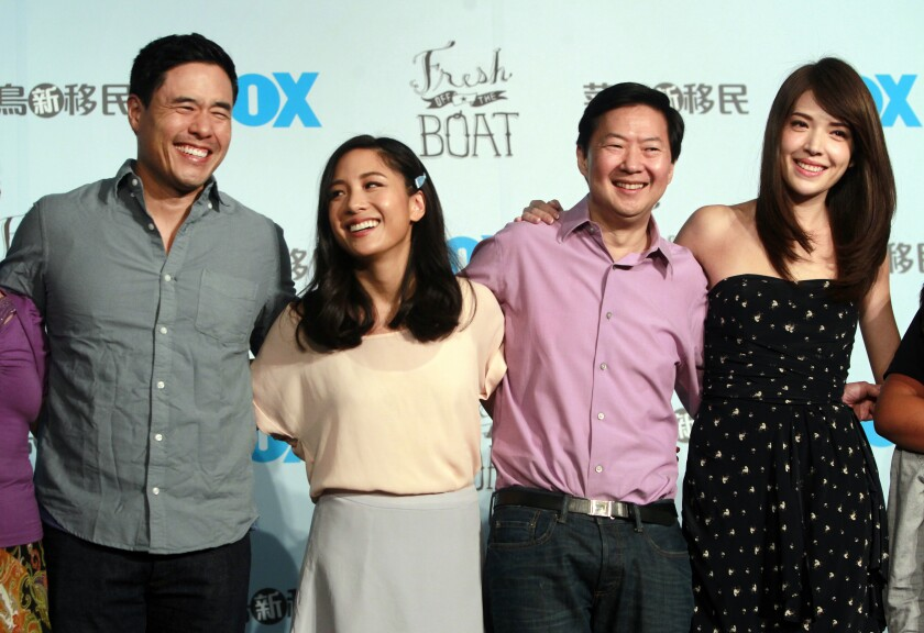 "FILE - In this Aug. 5, 2016 file photo, Randall Park, from left, Constance Wu, Ken Jeong and Ann Hsu pose for photographers during a media event announcing their comedy series ""Fresh off the Boat"" in Taipei, Taiwan. ABC's ""Fresh Off the Boat"" is coming to an end after six seasons. The network said Friday, Nov. 8, 2019, the comedy about an Asian American family in the 1990s will wrap with an hour-long finale. The last episode will air Feb. 21. (AP Photo/Chiang Ying-ying, File"