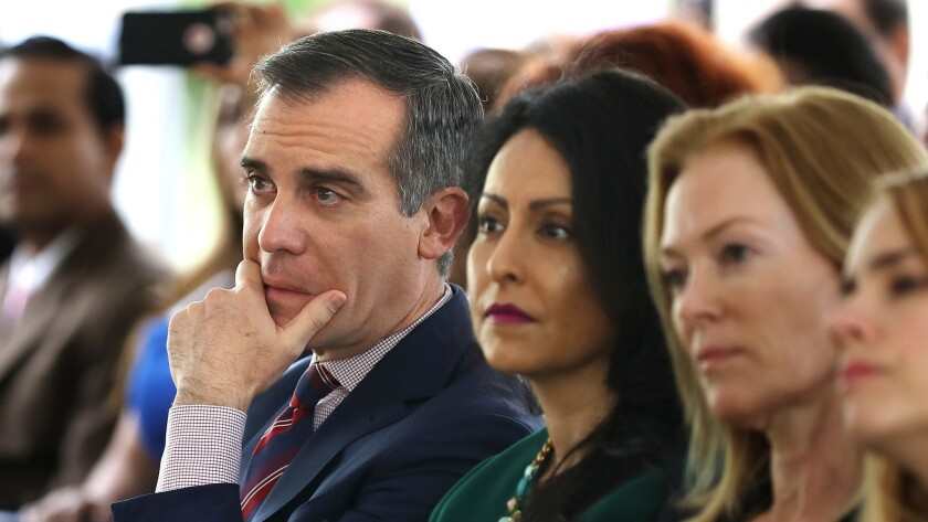 Mayor Eric Garcetti, left, and City Councilwoman Nury Martinez, center, listen to a panel of women discuss their experiences with sexual harassment in the workplace during the Getty House Foundation Women's Leadership Series in Los Angeles on April 30.