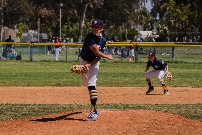 Samuel Cadavid, pitcher for the Jedis of the North Park Little League, delivers a strike at Morley Field.