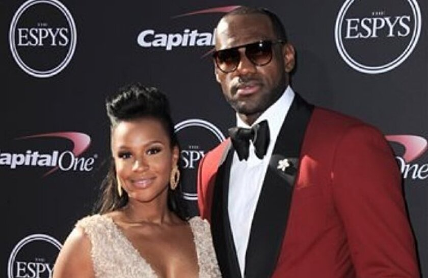 Miami Heat's LeBron James, right, and Savannah Brinson arrive at the ESPY Awards on Wednesday, July 17, 2013, at Nokia Theater in Los Angeles.