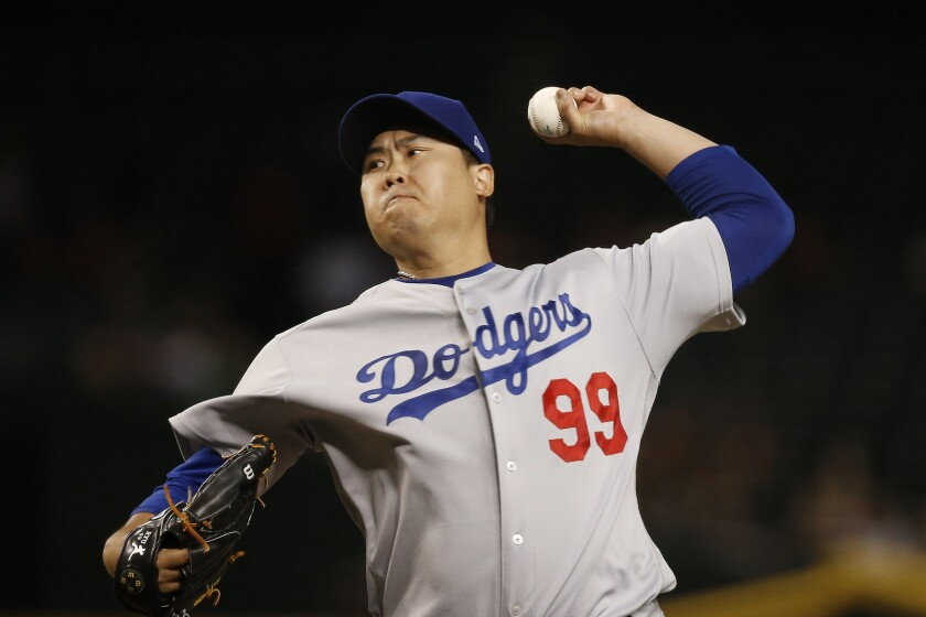 Hyun-jin Ryu delivers a pitch against the Diamondbacks.