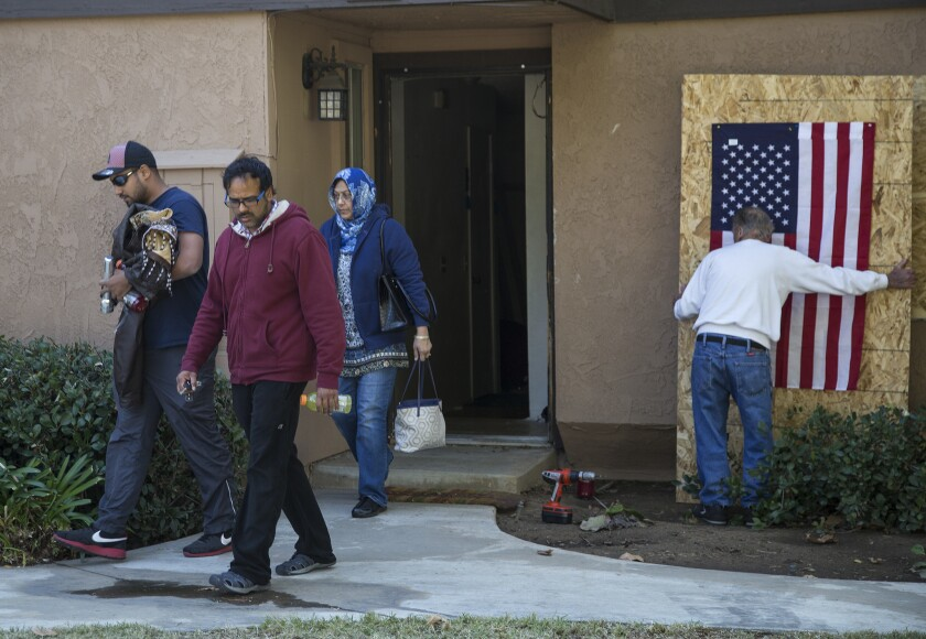 Family members of the San Bernardino shooters on Saturday removed personal items from the couple's rented townhouse in Redlands.