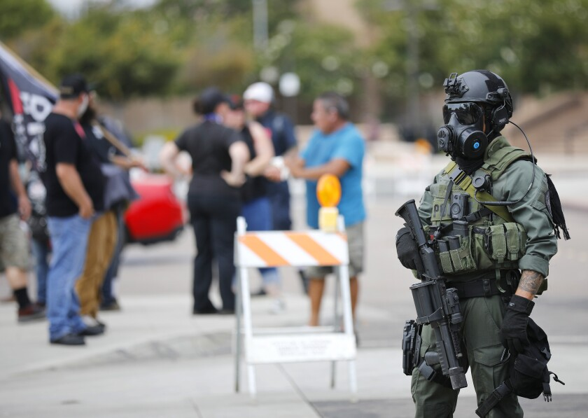 """El Cajon police in riot gear blocked off streets as Mike Pompeo, the former CIA director, spoke at """"We Are Israel"""" rally"""