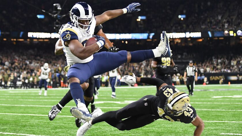 Rams running back Malcolm Brown leaps over Saints safety Marcus Williams to score a touchdown in November, 2018.