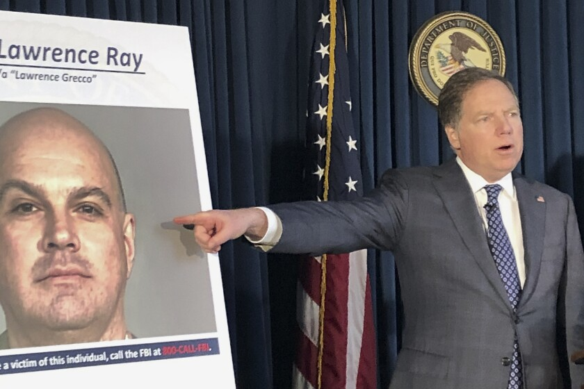 U.S. Atty. Geoffrey Berman announces the arrest of Lawrence Ray at a news conference Tuesday in New York.