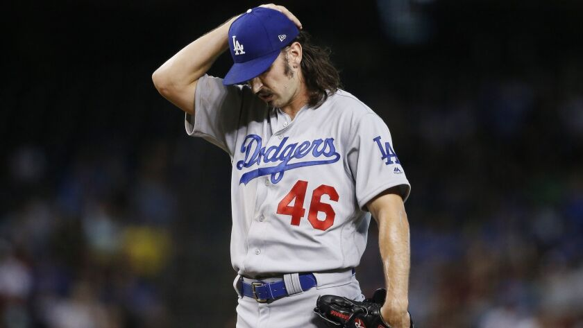 Los Angeles Dodgers starting pitcher Tony Gonsolin pauses on the mound during the first inning of a