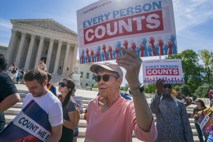 FILE - In this April 23, 2019 file photo, immigration activists rally outside the Supreme Court as the justices hear arguments over the Trump administration's plan to ask about citizenship on the 2020 census, in Washington. The Department of Homeland Security is agreeing to share citizenship information with the U.S. Census Bureau. The agreement was made in response to President Donald Trump's order to collect data on who is a citizen through administrative records following the Supreme Court's rejection of a citizenship question on the 2020 Census form. (AP Photo/J. Scott Applewhite, File)
