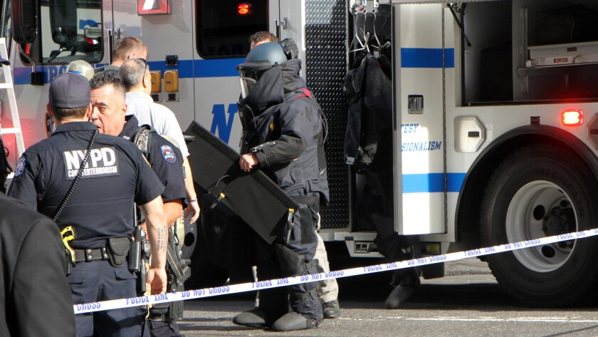 A bomb squad team investigates a suspicious package near Times Square a few days after a bomb exploded in the Chelsea neighborhood of Manhattan.