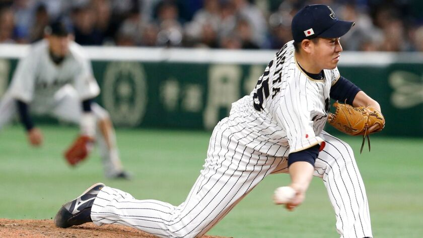 Japanese reliever Kazuhisa Makita pitches against Israel during the ninth inning of their second round game in the World Baseball Classic at Tokyo Dome in Tokyo, Wednesday, March 15, 2017.