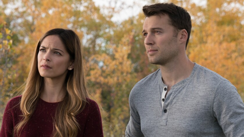"""Kristin Kreuk and Peter Mooney in """"Burden of Truth"""" on The CW."""