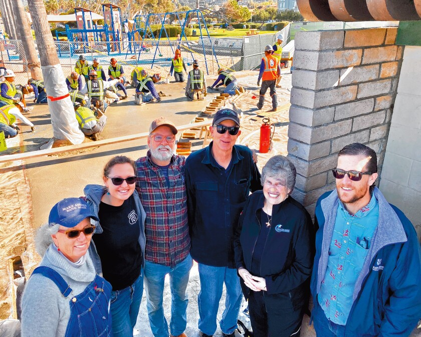 Project artist Robin Brailsford, art assistant Mariah Conner, project artist Wick Alexander, Grunow Construction project manager Bill Anderson, Mary Coakley-Munk and Shaw & Sons Concrete rep Jeff Counterman pose February 2020 at the sight of The Map installation in La Jolla Shores.