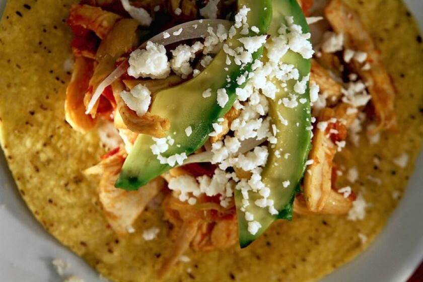 The tinga de pollo, or chicken in a chiptle-tomato sauce, is enhanced by using chipotles in a spicy-sweet pilocillo adobo.