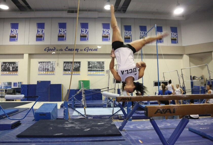 UCLA gymnast Sophina DeJesus finishes a routine on the balance beam during practice this week.