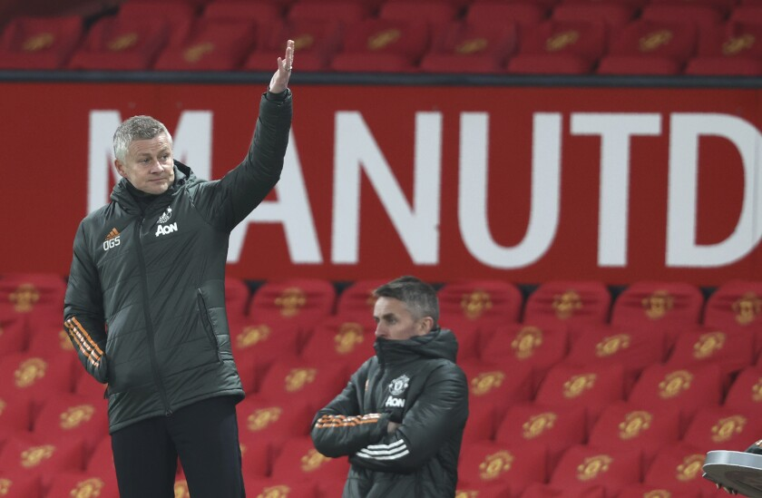 Manchester United's manager Ole Gunnar Solskjaer gives instructions from the side line during the English Premier League soccer match between Manchester United and Brighton and Hove Albion at Old Trafford, Manchester, England, Sunday, Apr. 4, 2021. (Clive Brunskill/Pool via AP)