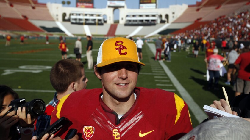 USC quarterback Cody Kessler speaks to reporters after the team's spring game at the Coliseum in April. With the school no longer under NCAA-imposed sanctions, will Kessler help the Trojans return to the top of the Pac-12?