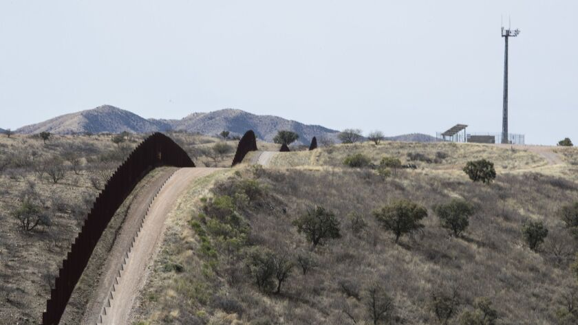 NOGALES, ARIZONA -- FRIDAY, MARCH 16, 2018: A fence along the U.S Mexican border west of Nogales, Ar