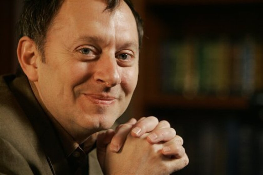 "FILE - In this Jan. 17, 2008 file photo, actor Michael Emerson, who plays Ben Linus in the ABC television series ""Lost,"" poses for photos during an interview in New York. (AP Photo/Richard Drew, file)"
