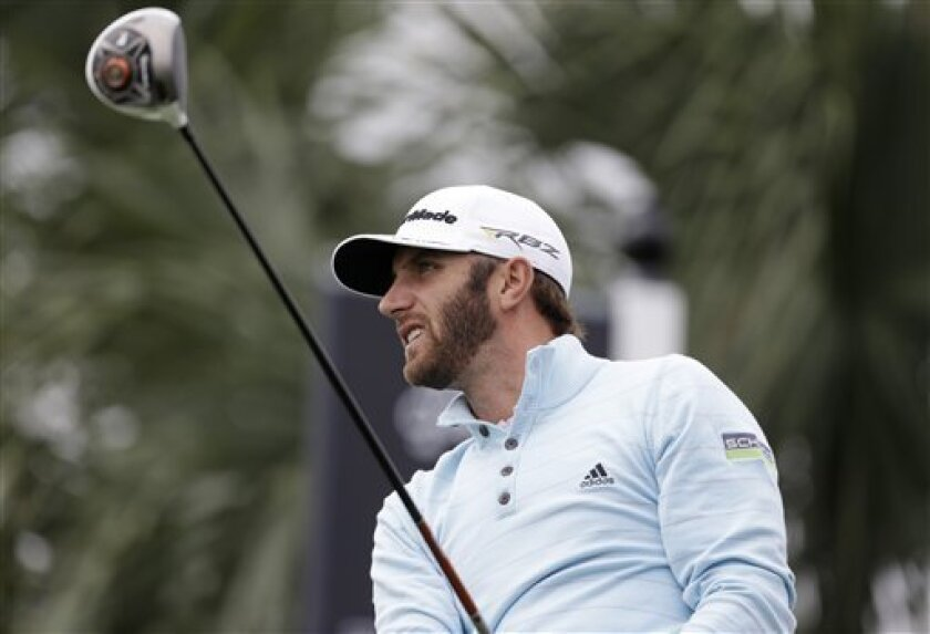 Dustin Johnson watches his shot after teeing off the 18th tee during the first round of the Honda Classic golf tournament, Thursday, Feb. 28, 2013 in Palm Beach Gardens, Fla. (AP Photo/Wilfredo Lee)