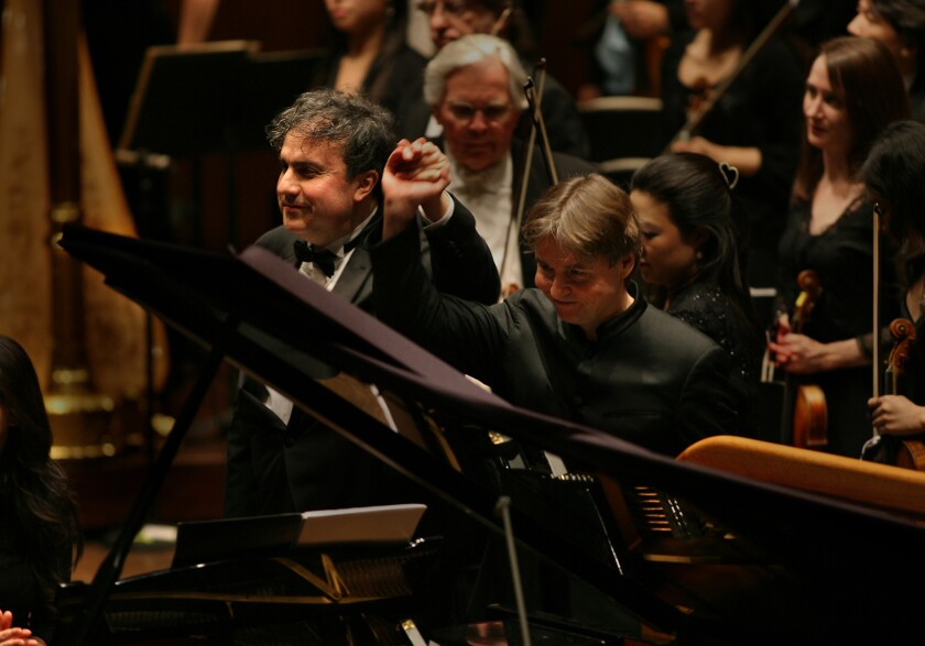 Yefim Bronfman taking a bow along with Esa -Pekka Salonen with the New York Philharmonic at Lincoln Center in 2007.
