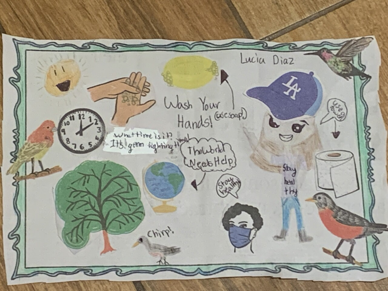 """Lucia Diaz, age 8, from Downey, submitted a drawing to jotform.com, """"I drew a tree with a robin next to it, and two hands with soap that say, """"wash you're hands!"""" And a girl with a towel saying, """" use a towel!"""", and a nurse saying,""""stay healthy"""", and a clock saying,"""" what time is it? It's germ fighting time!"""" a sun, and a globe that says,"""" the world needs help."""" Credit: Lucia Diaz"""